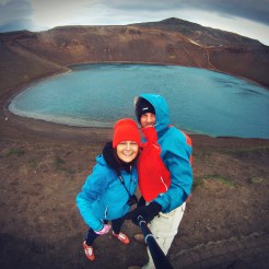 Selfie of traveling couple in front of lagoon in Iceland