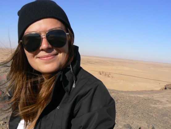 Woman wearing sunglasses in the Sudanese desert