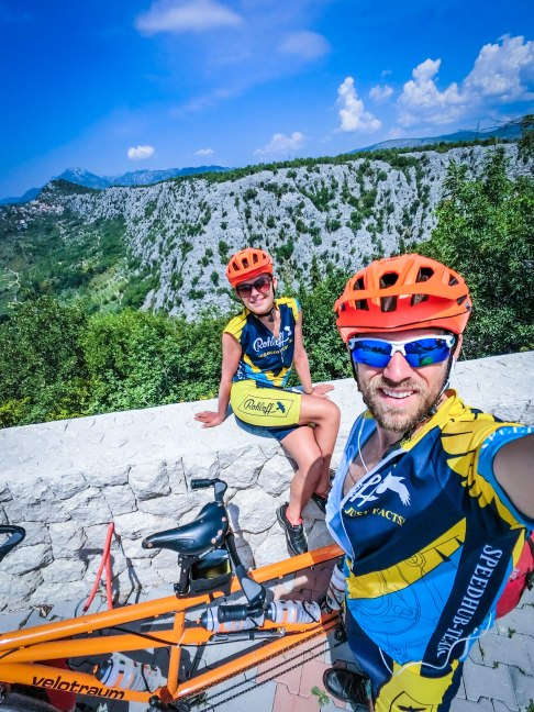 A bicycle couple with a tandem bicycle in the mountains in the Balkans