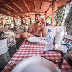 Topless man waiting for food in restaurant