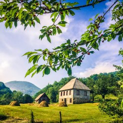 house and fields in the mountains