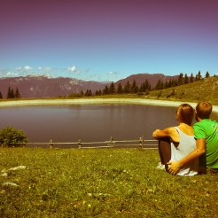 couple hugging in front of mountain lake