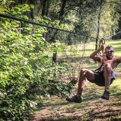 a man doing zipline