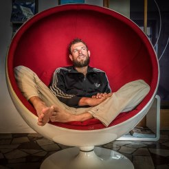 Man sitting in red chair