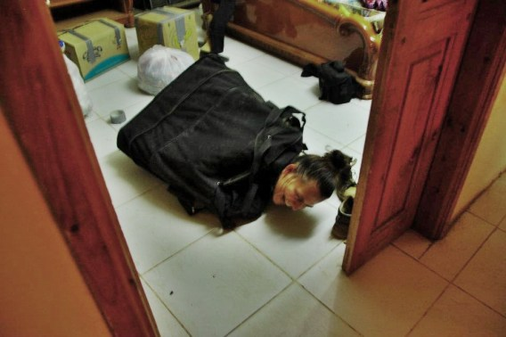 A woman packed in a suitcase / Packing Tips For Cycling Women