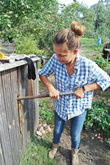 Marta Sobczak pumping up well water in Belarus