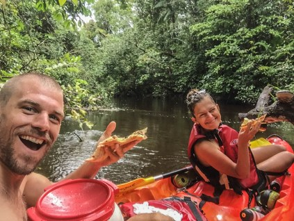 Kayaking in French Guiana - two happy people on a tandem