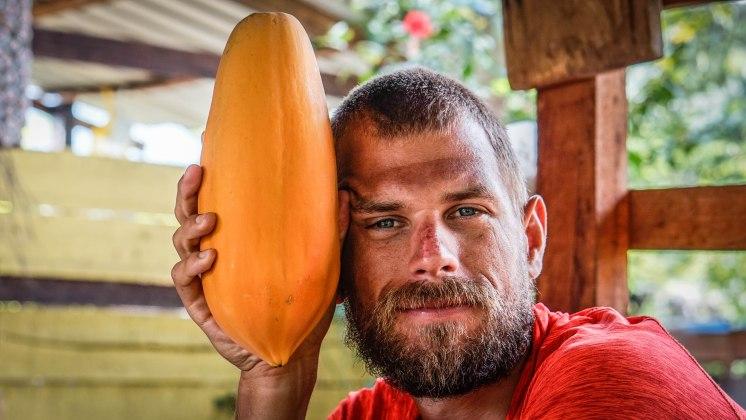 Man holding papaya
