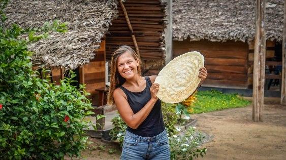 woman holding cassava bread