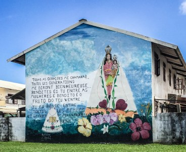 Painting of mother Maria holding Jesus on a house in Cayenne, French Guiana