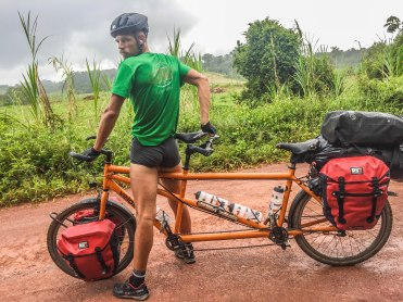 A man on a tandem bicycle in French Guiana