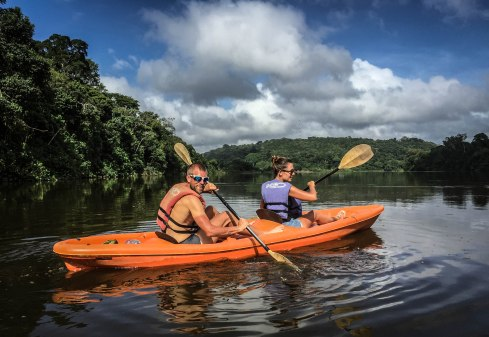 a couple on a kayak on a lake in Suriname