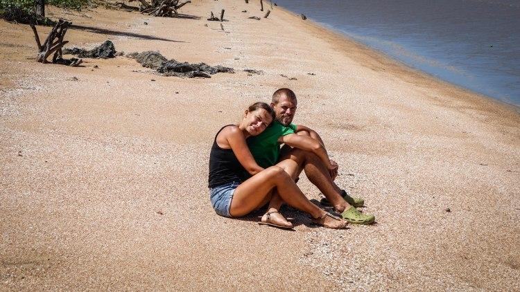 a happy couple on a sandy beach