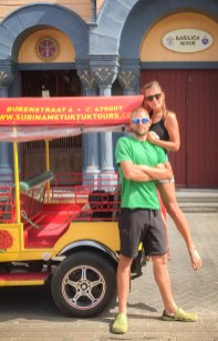 man standing in front of a woman on a tuk-tuk - City Tours