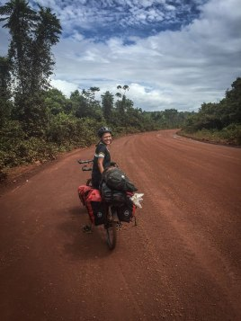 Woman on a tandem bicycle in the jungle / Cycling through South America