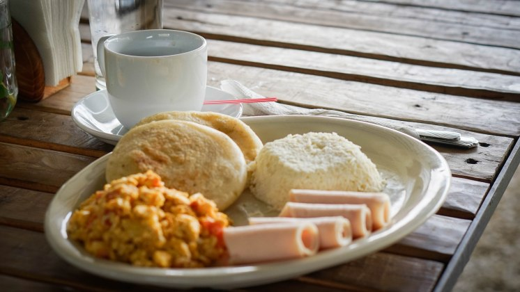 Two arepas ham, cheese and scrambled eggs