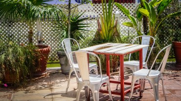 table with four chairs on the rooftop of Forty Winks