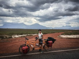 a woman on a tandem bicycle / Cycling through South America