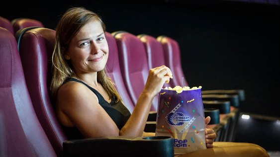 smiling women with popcorn