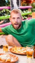 Traveler showing the peace sign during dinner,Introverts Traveling