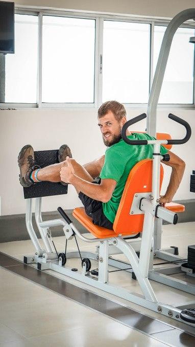 Blonde German man on a leg press machine