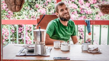 A smiling Introvert having cafe sitting on a table