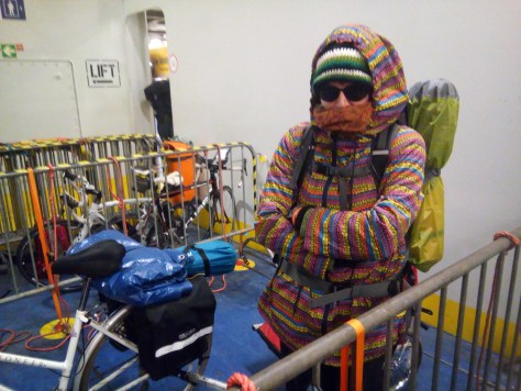 Freezing woman standing next to a bicycle