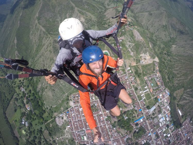 two men in Colombia doing paragliding