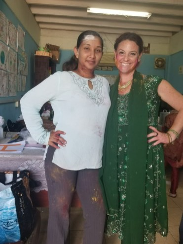 American woman standing next to a woman from Guyana