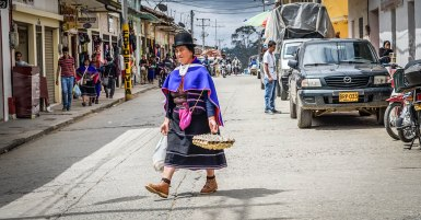 indigenous woman walking through the streets in Silvia, Colombia