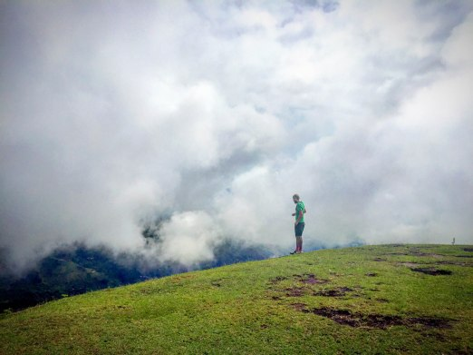 A man standing on a cloudy mountain in Roldanillo, Colombia