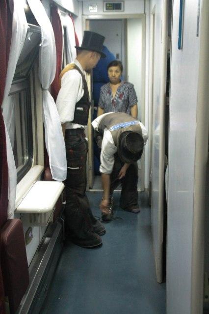 two man standing in train in Kazakhstan