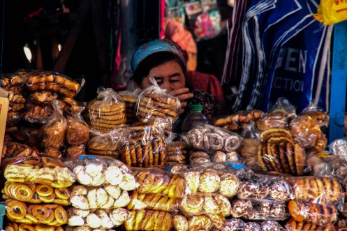 A woman selling pastry at the market / Hitchhiking journey