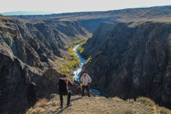 two people standing in front of a beautiful canyon in Kazakhstan