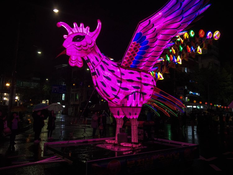 Bird statue in South Korean temple at night