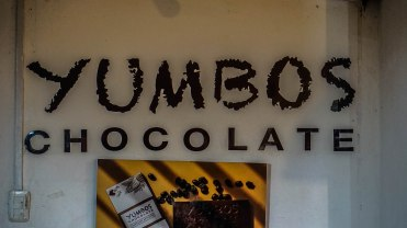 A sign which says: Yumbos chocolate
