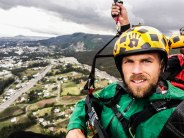 selfie of two men paragliding