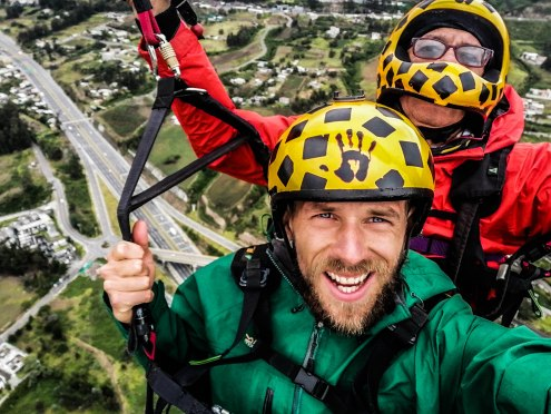 selfie of two men paragliding