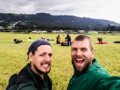 two men smiling on a field