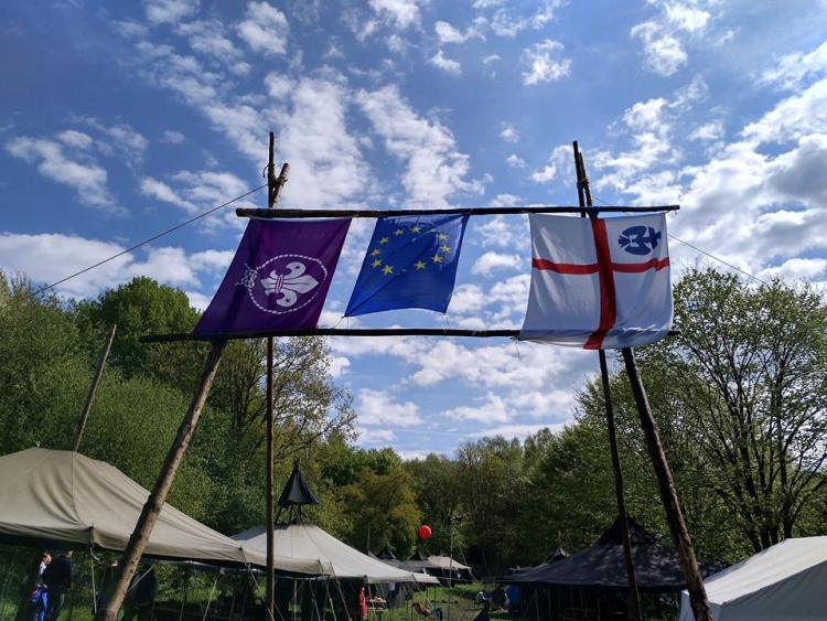 Several different youth scout flags