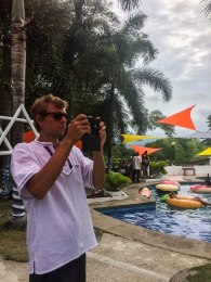 Man taking a picture on a pool