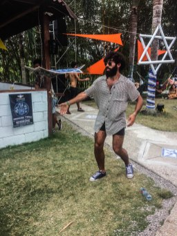 A bearder person dancing on a party