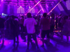 People dancing indoors at a festival