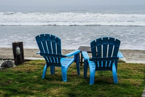two beach chairs on a sandy beach