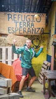 """A man posing in front of a sign """"Terra Esperanza"""" in Ecuador"""