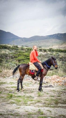 A man sitting on a horse in Ecuador