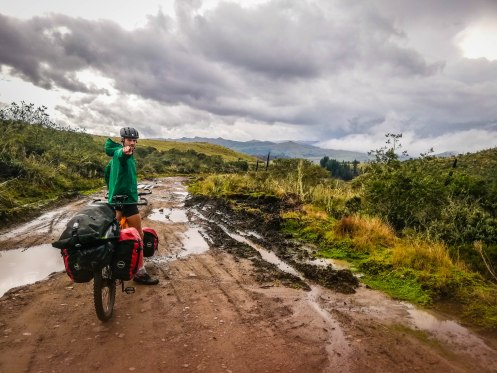 A man on a tandem bicycle in the countryside of Tulcan, Ecuador