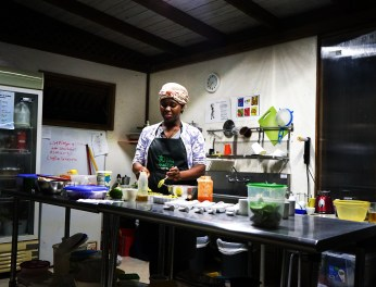 black women cooking in outdoor kitchen at the Clave Verde Ecolodge