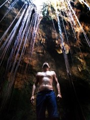 topless man in a cave