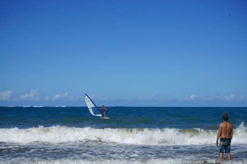 a man on windsurfing board